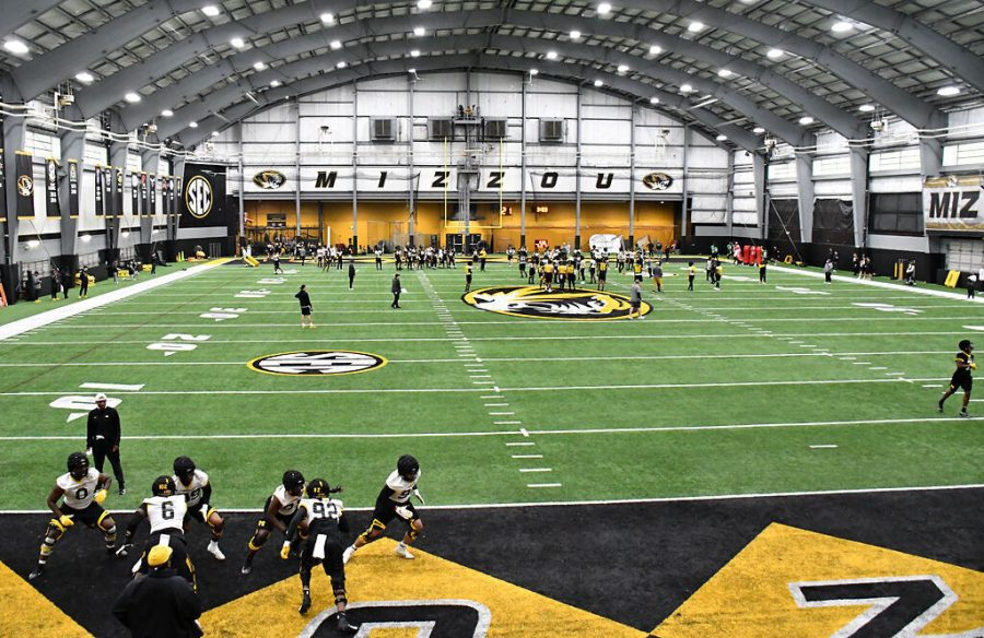 The+Missouri+football+team+practices+Thursday+in+Columbia.+Due+to+the+rain%2C+practice+was+moved+inside+for+the+day.
