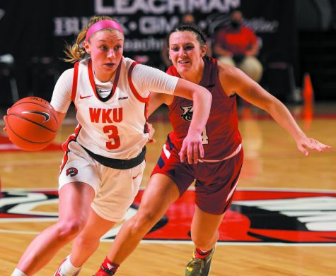 WKU guard Ally Collett (3) dribbles the ball across the court while FAU guard Are Beck (4) follows closely behind at the game at Diddle Arena on Feb. 5, 2021. WKU won 71-64.