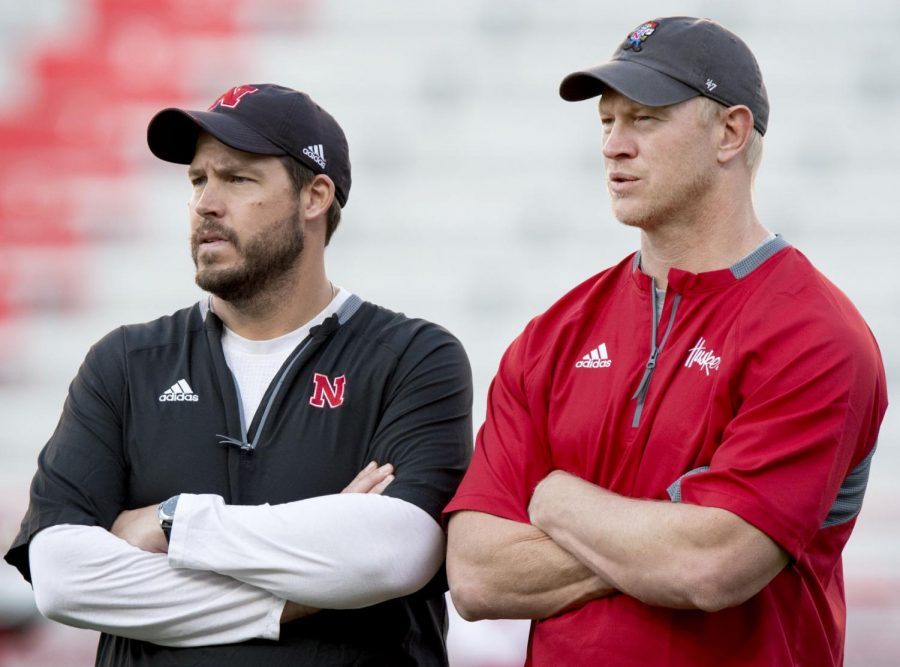 Nebraska head coach Scott Frost (right) watches the work on the field with Huskers defensive coordinator Erik Chinander during the Friday Night Lights event at Memorial Stadium in 2018.