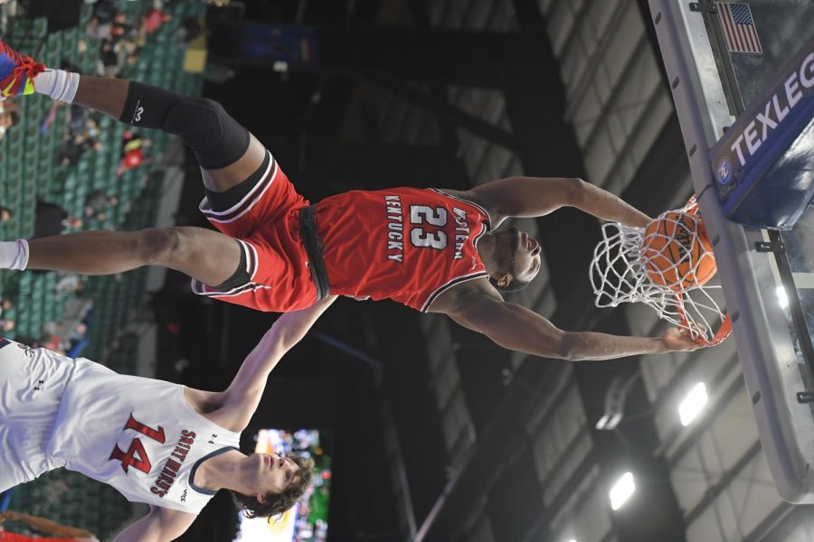 Junior Charles Bassey (23) slamming home a dunk over sophomore Kyle Bowen (14) during the first round of the NIT on March 17, 2021. WKU would go on to win 69-67 over the Saint Marys Gaels.