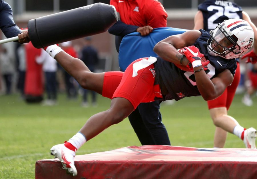 Receiver+Jamarye+Joiner+plunges+through+the+pads+and+onto+a+mat+while+the+Wildcat+ball+carriers+work+on+a+goal+line+plunges+during+the+University+of+Arizona+practice+for+their+spring+season%2C+Tucson%2C+Ariz.%2C+March+25%2C+2021.