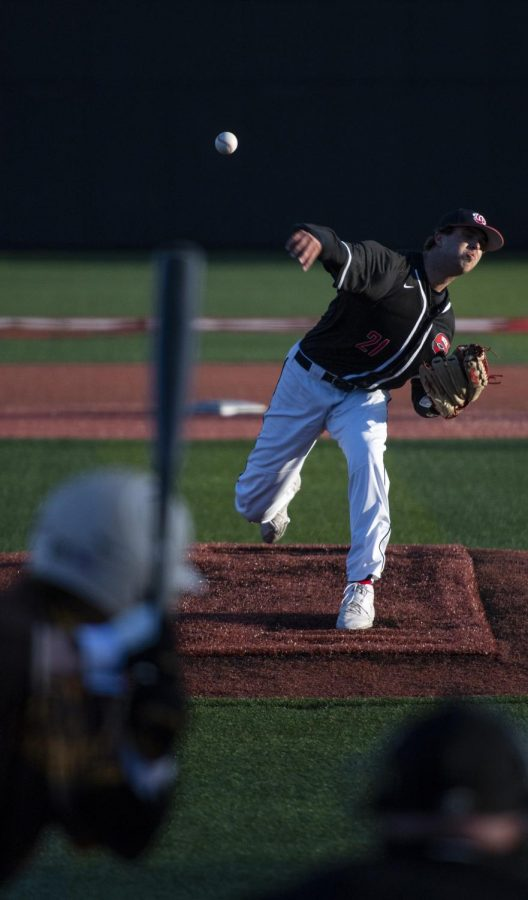 WKU right handed pitcher Jake Kates (21) pitches during the game against Valparaiso at Nick Denes Field on Mar. 19, 2021. WKU won 8-4.