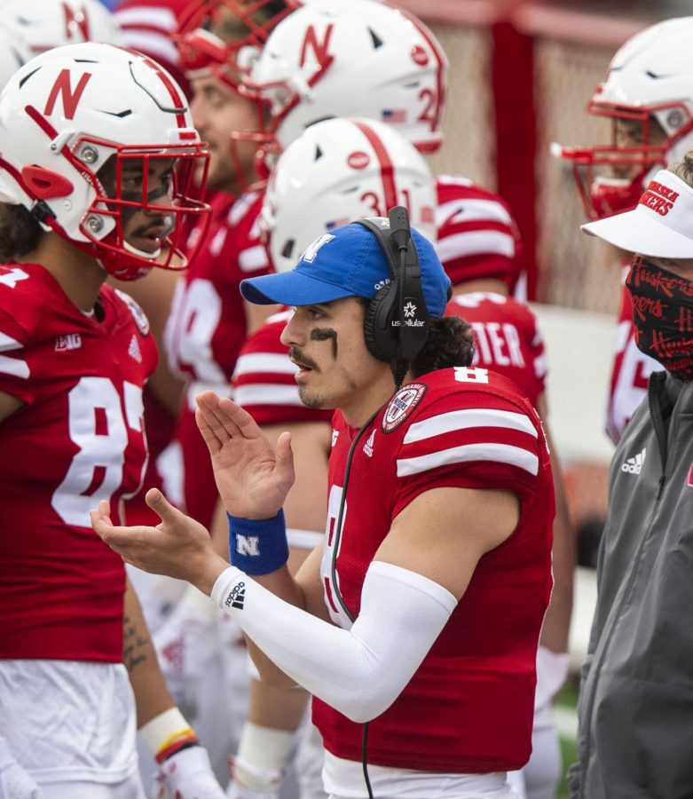 Nebraska quarterback Logan Smothers (8) cheers on his team from the sideline during the Penn State game in November at Memorial Stadium.