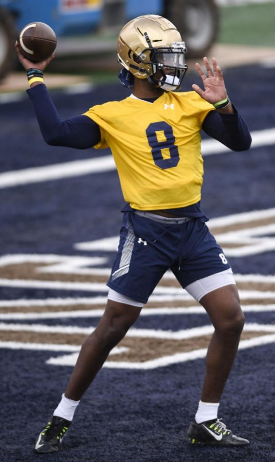 Montana State quarterback Matthew McKay runs a drill during the first day of spring practice Tuesday at Bobcat Stadium.