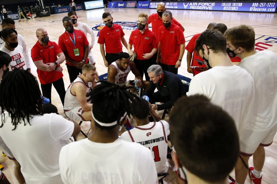 Head+coach+Rick+Stansbury+in+the+huddle+with+the+Hilltoppers+in+the+midst+of+a+timeout.+WKU+played+UAB+in+the+C-USA+Semifinal+winning+64-60+to+advance+to+the+Championship+game.%C2%A0