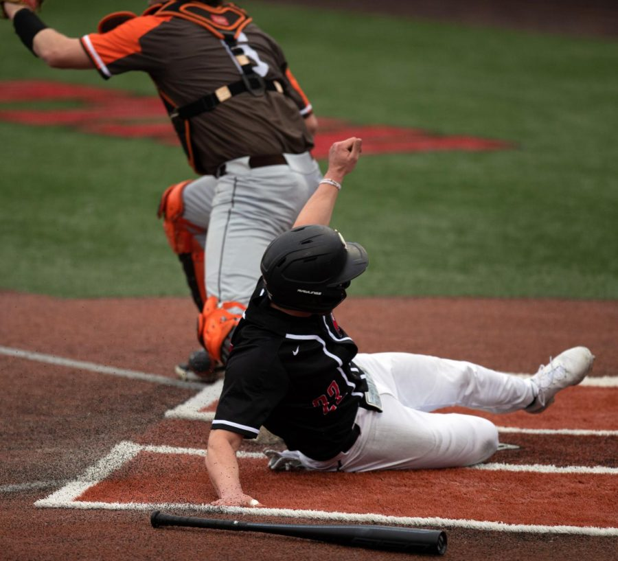 WKU redshirt freshman TY Crittenberger (22) slides into home during the game against the Bowling Green Falcons at Nick Denes Field on March 12.
