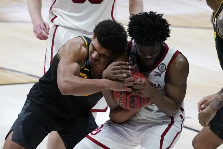 Missouri guard Mark Smith, left, fights for a loose ball with Oklahoma guard Elijah Harkless, right, during a first-round game in the NCAA Tournament on Saturday at Lucas Oil Stadium in Indianapolis.