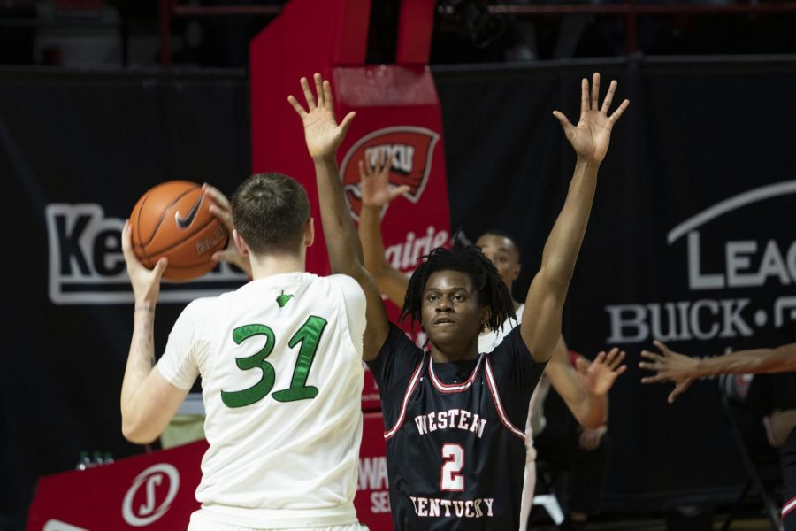 Western Kentucky University forward Kevin Osawe (2) guards Marshall University senior Mikel Beyers (31) during the WKU vs. Marshall University game in Diddle Arena on Jan. 15, 2021. The WKU Hilltoppers defeated the Marshall Thundering Herd 81-73.