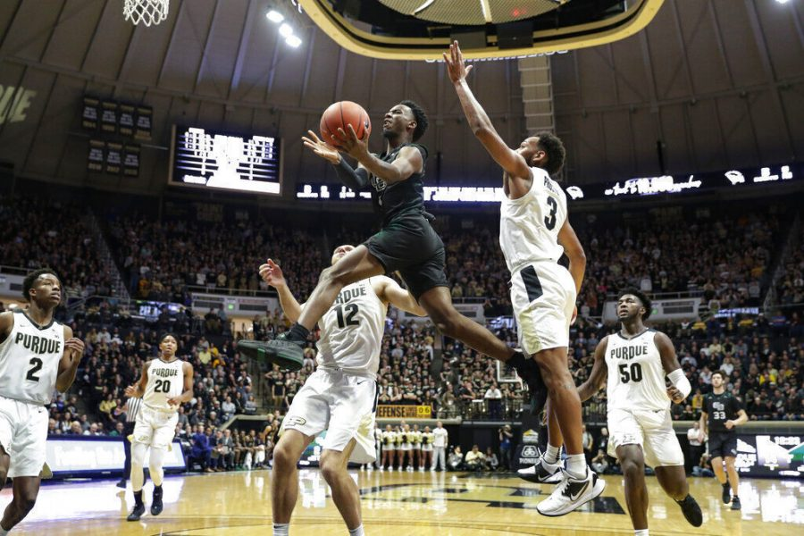 Green Bay guard Amari Davis (1) shoots between Purdue forward Evan Boudreaux (12) and guard Jahaad Proctor (3) during a Nov. 6, 2019 game in West Lafayette, Ind. Davis committed to Missouri on Thursday after entering the transfer portal.