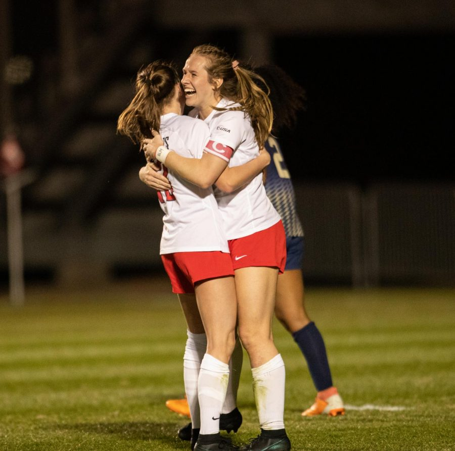 WKU women's soccer player Katie Erwin (13) celebrates with her teammate Ambere Barnett (15) after a big goal to put Western up two goals against their opponent FIU after their game on March 4, 2021.