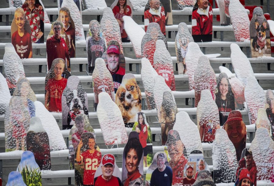 Fan+cutouts+in+the+East+Stadium+stands+receive+a+patina+of+overnight+snow+last+season+at+Memorial+Stadium.
