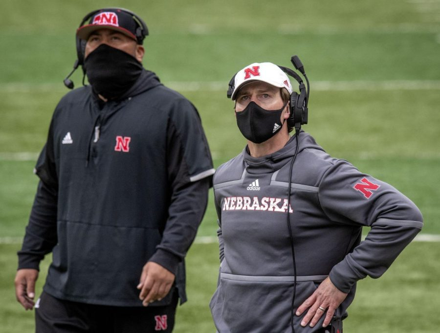 Nebraska assistant coaches Tony Tuioti (left) and Barrett Ruud watch the video board during a second-half timeout against Illinois on Nov. 21 at Memorial Stadium.