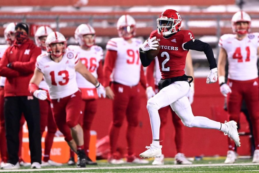 Rutgers' Aron Cruickshank returns a kickoff 98 yards for a touchdown during the third quarter against Nebraska on Dec. 18 in Piscataway, New Jersey.