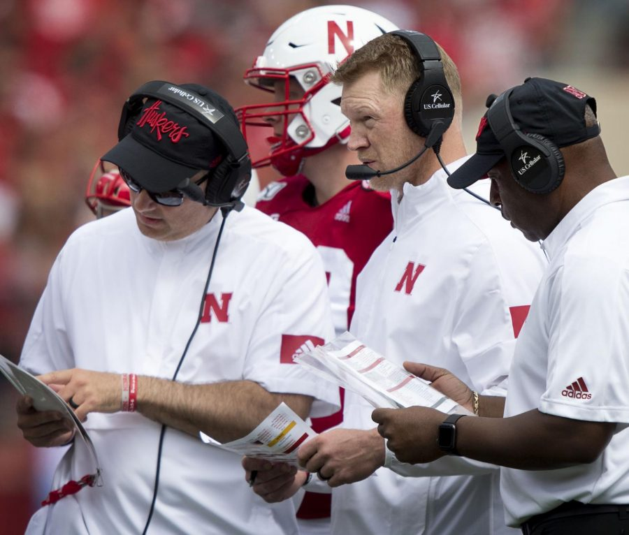 Nebraska head coach Scott Frost confers with assistant coaches Ryan Held (left) and Sean Beckton during the second quarter against South Alabama on Aug. 31, 2019, at Memorial Stadium.