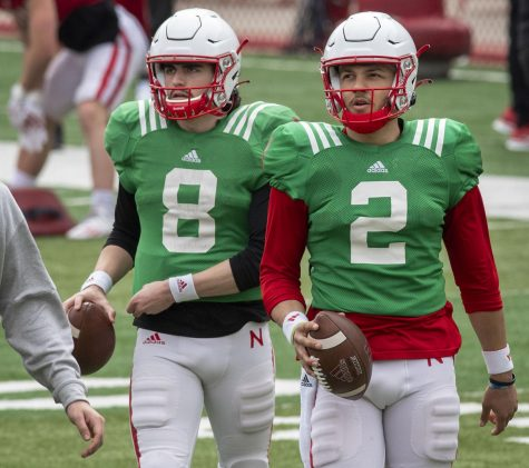 Nebraska quarterbacks Logan Smothers (8) and Adrian Martinez walk across the field during a football practice Saturday at Memorial Stadium.