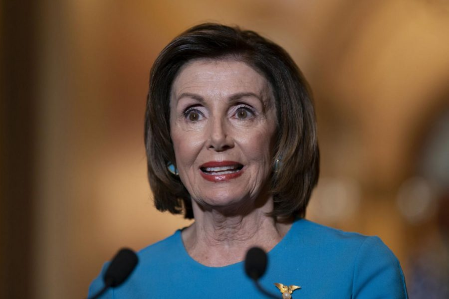 Speaker of the House Nancy Pelosi, D-Calif., makes a statement about a coronavirus aid package, on Capitol Hill in Washington, Friday, March 13, 2020.