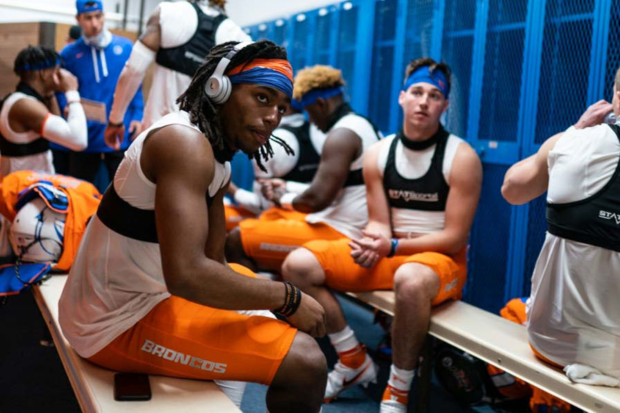 Boise+State+wide+receivers+Latrell+Caples+%28left%2C+headphones%29+and+Maclaine+Griffin+%28center%2C+blue+head+band%29+and+teammates+wear+GPS+vests+as+they+get+ready+for+the+spring+game+on+April+10+at+Albertsons+Stadium.