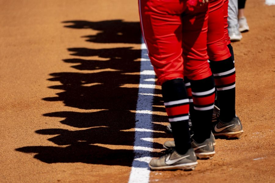 WKU softball players stand on the foul line during the national anthem before the game against UAB Saturday, March 20, 2021.