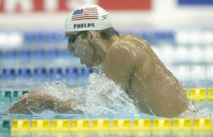 YOKOHAMA-+AUGUST+25%3A+Michael+Phelps+from+the+USA+swimming+in+the+400m+individual+medley+heats+during+the+2002+Pan+Pacific+Swimming+Championships+at+Yokohama+swimming+pool+in+Yokohama%2C+Japan+on+August+25%2C+2002.+%28Photo+by+Sean+Garnsworthy%2FGetty+Images%29.