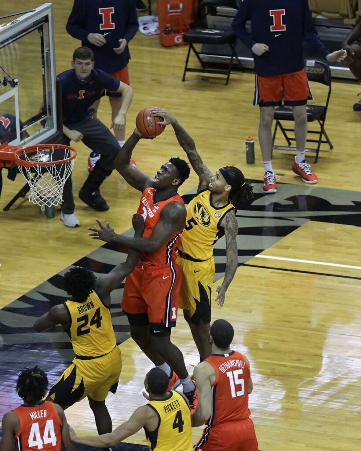 Missouri forward Mitchell Smith blocks Illinois center Kofi Cockburn as he goes up for a basket Dec. 12 at Mizzou Arena in Columbia. Smith announced via his Instagram on Tuesday that he had signed with JCK Sports Group and was going to attempt to sign with a professional team.