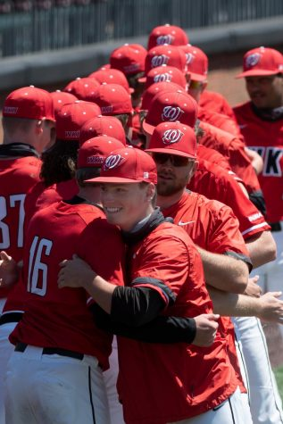 The WKU Hilltoppers baseball team embrace one another before their game against Marshall College on April 11, 2021 at Nick Denes Field where WKU won 8-1.