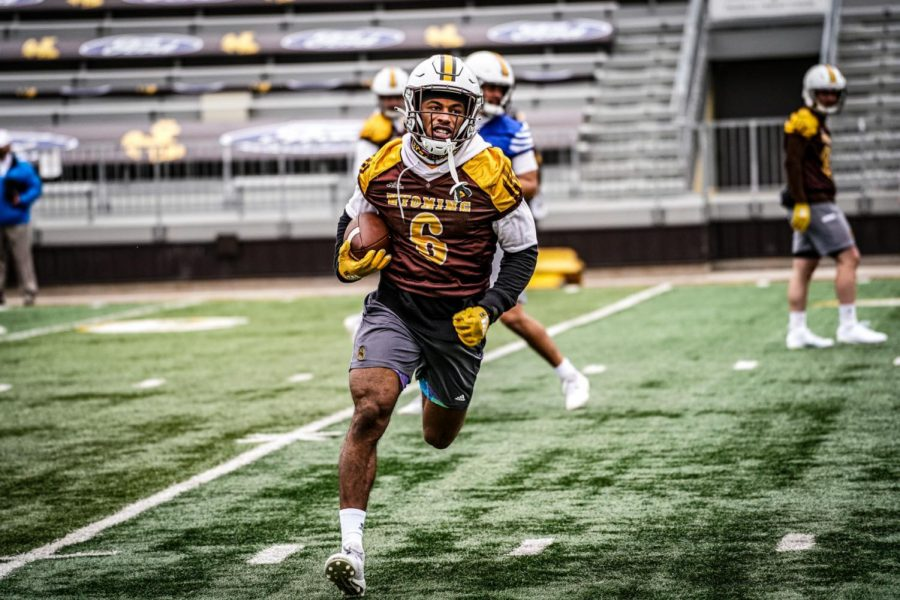 Wyoming+running+back+Xazavian+Valladay+runs+through+a+drill+during+spring+practice+April+6+at+War+Memorial+Stadium+in+Laramie.
