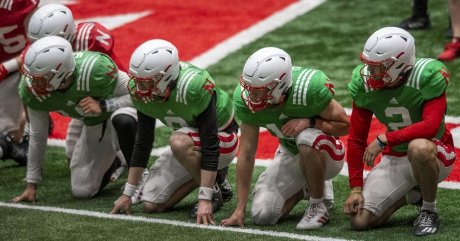 Nebraska quarterbacks (from left to right) Matt Masker, Logan Smothers, Heinrich Haarberg and Adrian Martinez await the start of a sprintduring a spring football practice Wednesday at Hawks Championship Center.