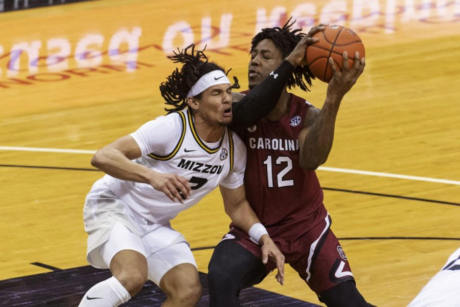 South+Carolina%E2%80%99s+Trae+Hannibal%2C+right%2C+runs+into+Missouri%E2%80%99s+Drew+Buggs+during+the+first+half+of+a+game+Tuesday+in+Columbia.+On+Wednesday%2C+Buggs+announced+he%E2%80%99d+be+exercising+his+extra+year+of+eligibility+and+entering+the+transfer+portal.