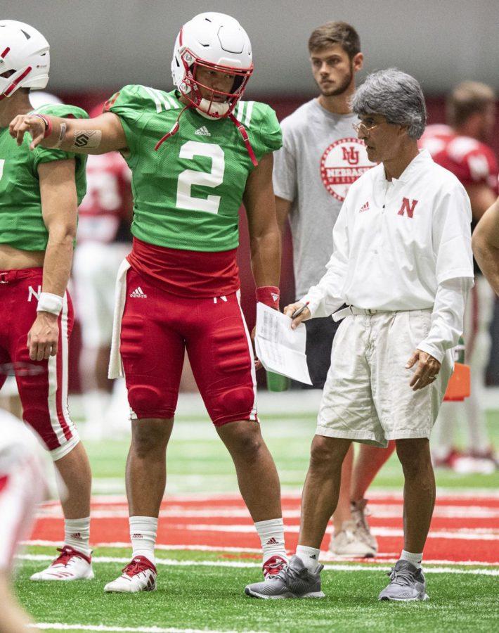 Nebraska quarterback Adrian Martinez (2) talks to quarterbacks coach Mario Verduzco during an Aug. 7, 2019, practice at the Hawks Championship Center.