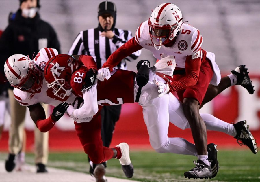 Rutgers receiver Christian Dremel comes down with the ball between Nebraska defensive backs Deontai Williams (left) and Cam Taylor-Britt last December in Piscataway, New Jersey.