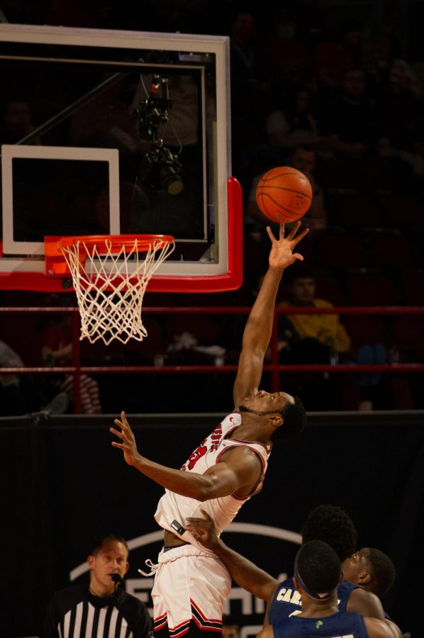 Charles Bassey (23) scores on a fast break play as WKU Hilltoppers pick up the win 91-58 during their game against the FIU Panthers.