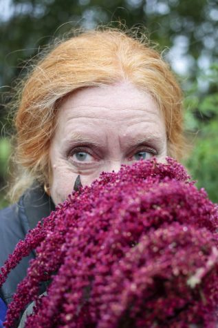 """Sometimes I just grow stuff to see what it looks like or because I read a story about it,"" said Erika Brady. Brady holds the fuchsia Callaloo amaranth, which is known for its grain. Dr. Brady remembers that her grandfather used to talk about a fish stew from his home of St. Croix that used the plant"