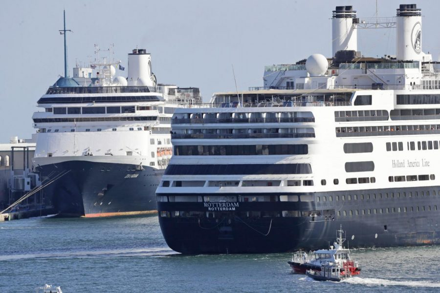 The cruise ship Rotterdam (right) passes the Zaandam as it prepares to dock Thursday, April 2, at Port Everglades in Fort Lauderdale, Fla.