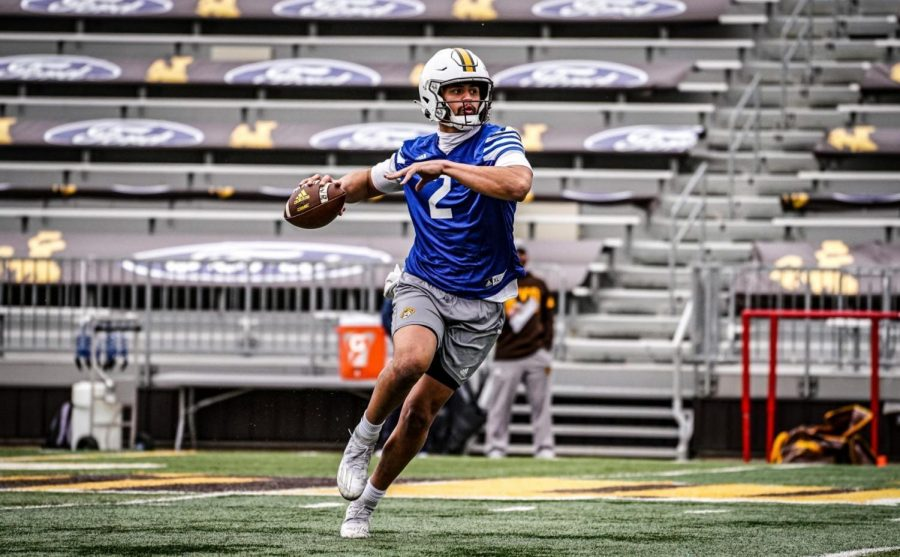 Wyoming quarterback Sean Chambers looks to pass during the Cowboys' spring practice Tuesday at War Memorial Stadium in Laramie. Chambers, who's changed his jersey number from No. 12 to No. 2, entered the spring with a clean bill of health after sustaining his third season-ending injury in as many seasons last fall.