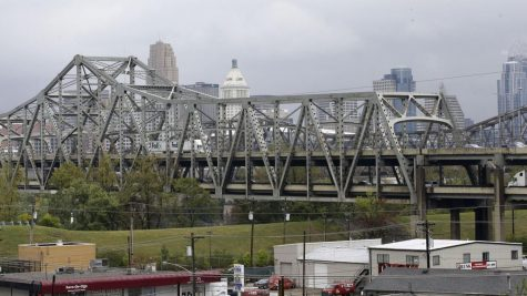 In this Oct. 7, 2014, file photo, traffic on the Brent Spence Bridge passes in front of the Cincinnati skyline while crossing the Ohio River to and from Covington, Ky. The Brent Spence Bridge is carrying tens of thousands more vehicles a day than it was designed to handle.