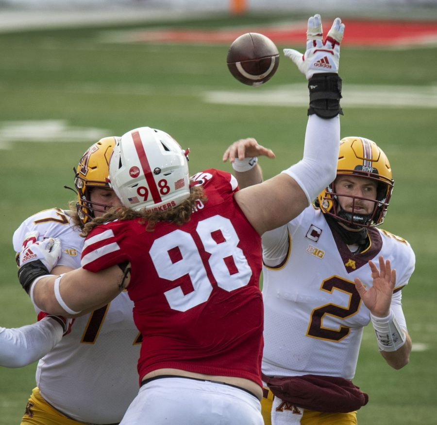 Nebraska defensive lineman Casey Rogers (98) gets a hand on a fourth-down pass from Minnesota QB Tanner Morgan (2) in a Dec. 12, 2020, game at Memorial Stadium.
