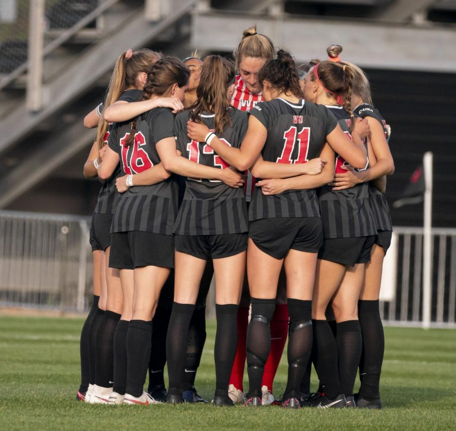 WKU soccer players huddled up prior to kickoff against Charlotte on Friday, April 9, 2021.