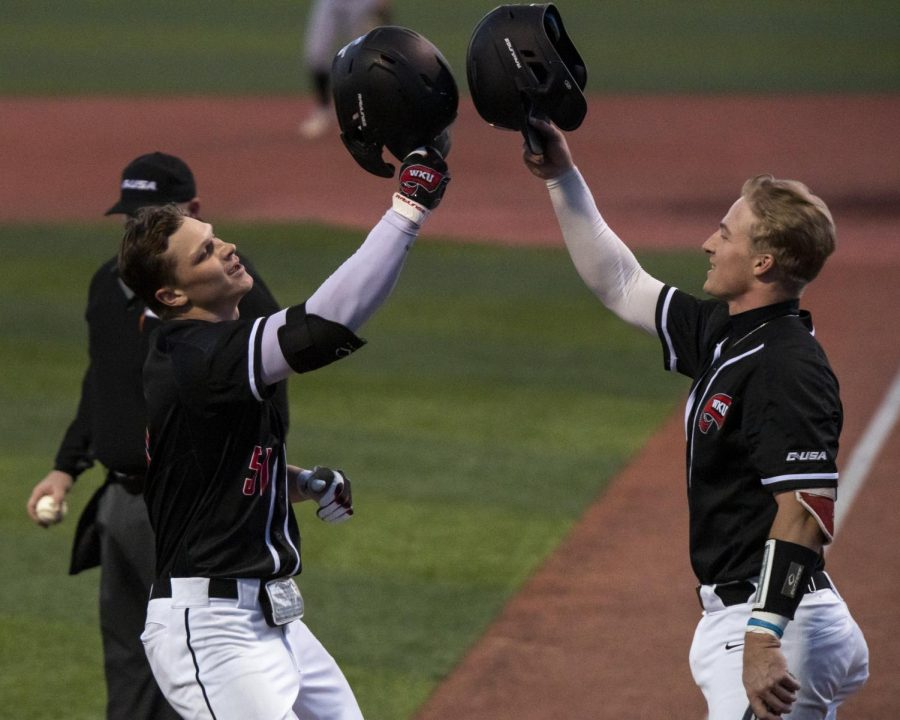 WKU outfielder Jackson Gray (51) is congratulated by catcher Hunter Evans (4) after Gray hit his first home run as a Hilltopper that also helped Evans score during the game against Valparaiso at Nick Denes Field on Mar. 19, 2021. WKU won 8-4.