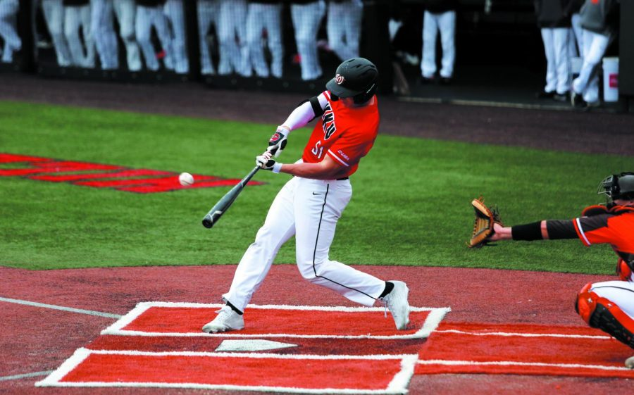 WKU outfielder Jackson Gray (51) swings at a pitch during the game against the Bowling Green Falcons at Nick Denes Field on March 14. WKU won 17-16.