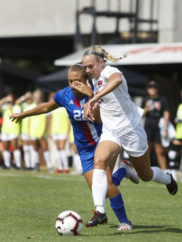 WKU Lady topper forward Ansley Cate (20) advance towards the box while being defended by Louisiana Tech Forward Kaylee Zettler (22) during the game at the WKU Soccer Complex on Sunday Sept. 29, 2019.