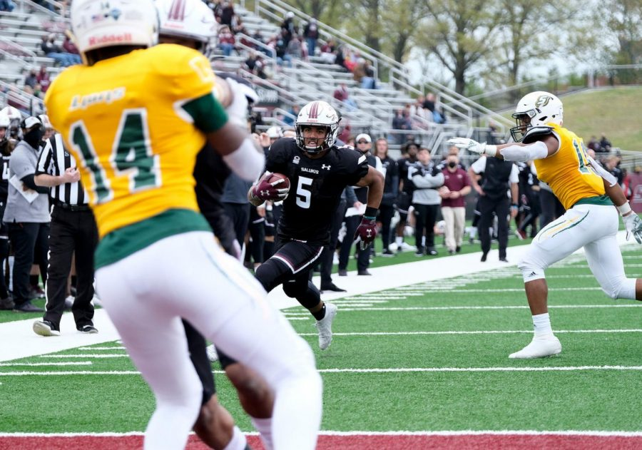 SIU running back Justin Strong (5) finds his way into the end zone on a 9-yard touchdown run during the fourth quarter against Southeastern Louisiana at Saluki Stadium on Saturday in Carbondale. The Salukis went on to win 55-48.