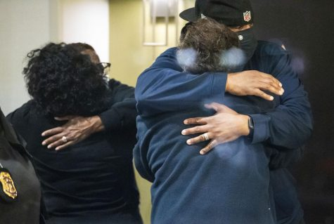 People hug Friday after learning that their loved one is safe after a shooting Thursday night inside a FedEx building. Multiple people were shot and killed in a late-night shooting at a FedEx facility in Indianapolis, and the shooter killed himself, police said.