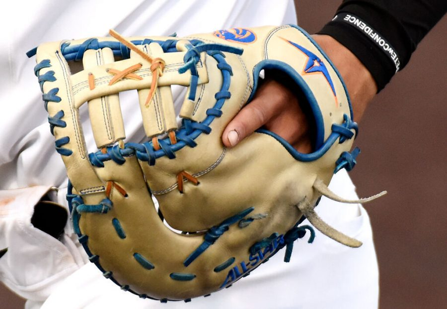 Missouri+sophomore+Torin+Montgomery+is+seen+wearing+his+glove+embroidered+with+the+Boise+State+logo+as+he+runs+back+into+the+dugout+Feb.+27+at+Taylor+Stadium.