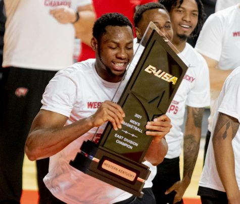 WKU Junior center, Charles Bassey (23) celebrates the Conference USA Regular season Championship game against Old Dominion on Saturday, March 6, 2021 in Diddle Arena.