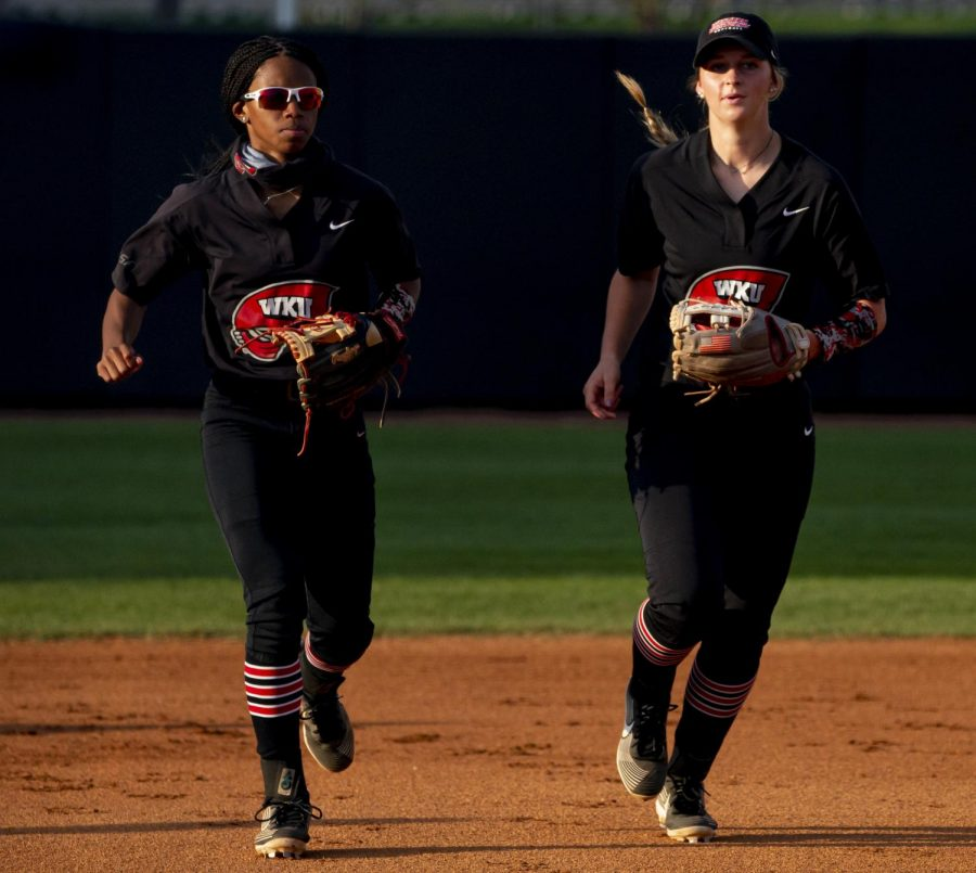 WKU infielder, TJ Webster (left) WKU infielder, Kennedy Foote (right) running back to the dugout during the game against Eastern Kentucky on Wednesday, April 7, 2021. The Hilltoppers would go on to fall 1-0 to EKU.