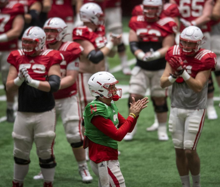 Nebraska quarterback Adrian Martinez (2) leads the team during warmups at a spring football practice Wednesday at Hawks Championship Center.