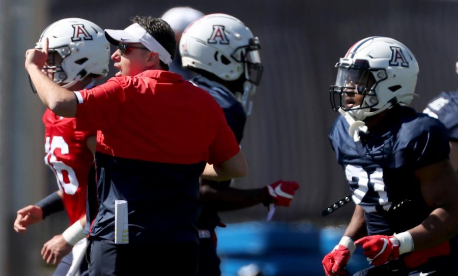 """Head coach Jedd Fisch sends his players to their next station during a turnaround between drills at practice last week.""""We need to do better on offense,"""" he said. """"We can't turn the ball over."""""""