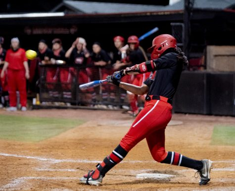 WKU pitcher, Kennedy Sullivan (4) hits a walk off hit in the 9th inning during the game against Kentucky on Wednesday, March 24, 2021.