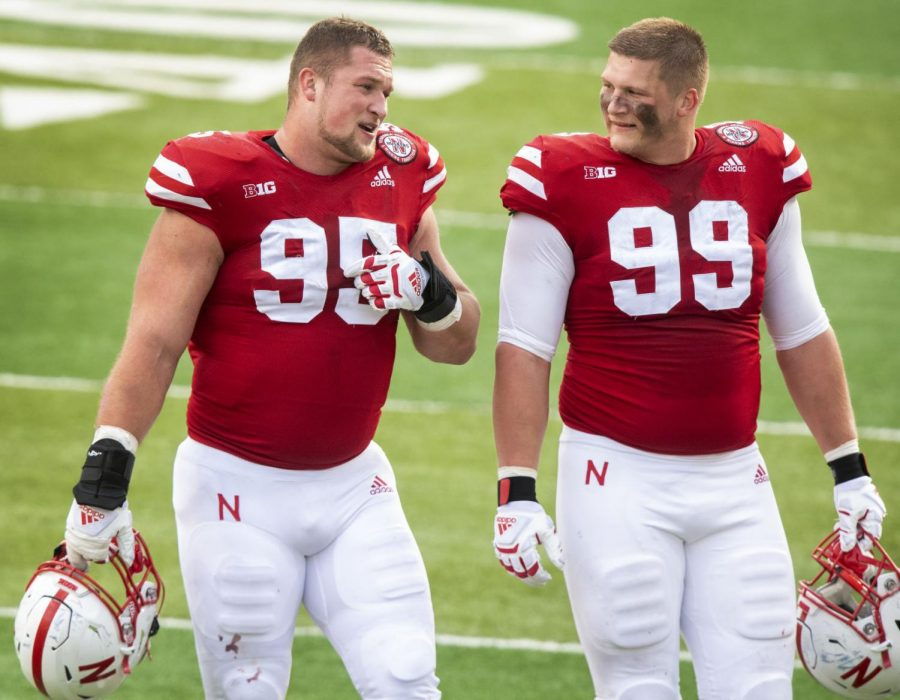 Nebraskas Ben Stille (95) and Ty Robinson walk off the field after the Huskers 30-23 win over Penn State on Nov. 14, 2020, at Memorial Stadium.