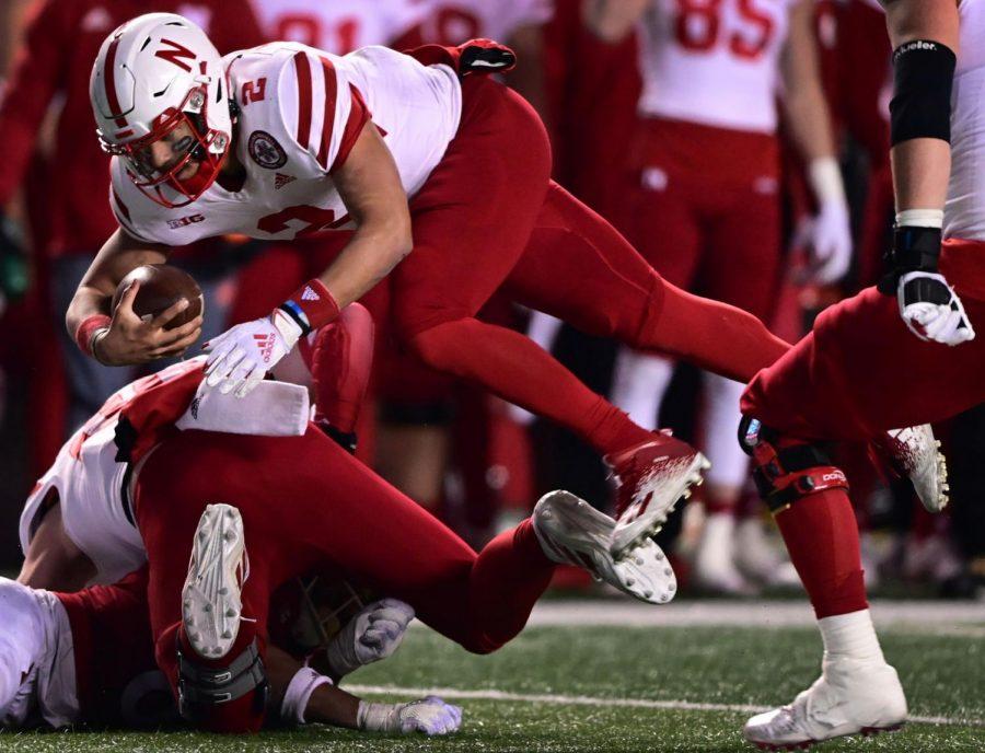 Nebraska quarterback Adrian Martinez dives for yardage against Rutgers last December in Piscataway, New Jersey.